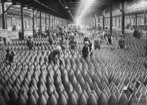 MUNITIONS PRODUCTION ON THE HOME FRONT, 1914-1918 (Q 30018) Munition workers in a shell warehouse at the National Shell Filling Factory, Chilwell, Nottinghamshire. This was one of the largest shell factories in the country. Around 21 August, 1917. Copyright: © IWM. Original Source: http://www.iwm.org.uk/collections/item/object/205193214